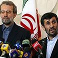 Ahmadinejad and Larijani Photo: AFP