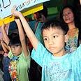 Children protest against deportation last month Photo: Yaron Brener