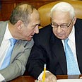 PM Sharon and Ehud Olmert during government meeting