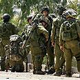Soldiers near Kissufim crossing Photo: AP