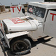 TV jeep used to break through to Israel Photo: Amir Cohen