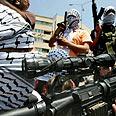 Gunmen stand in Gaza street Photo: AFP