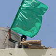 Hamas flag flying on roof of PA building Photo: AP