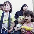 Palestinian children waiting at Erez crossing Photo: Reuters