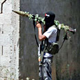 Hamas gunman with antitank missile launcher Photo: AP