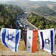 Israeli and Syrian flags at the entrance to Jerusalem Photo: Dolev Gottleib