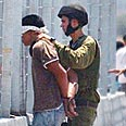 Soldier detaining Palestinian in West Bank Photo: AP