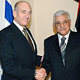 Olmert with Abbas Photo: Amos Ben Gershom