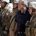 George Bush visiting troops in Iraq Photo: Reuters