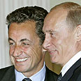 Putin (R) and Sarkozy Photo: AFP