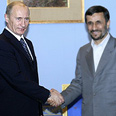 Strengthening ties? Putin and Ahmadinejad in Tehran Photo: AFP
