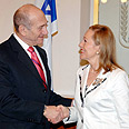 Business as usual. Olmert with EU commissioner, Monday morning Photo: GPO