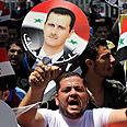 Pro-Assad rally Photo: EPA