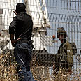 Taking down the fence in Bilin Photo: EPA