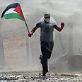 Protestor at Bilin fence Photo: AFP