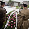 Members of Romanian army carry flowers during ceremony Photo: AFP