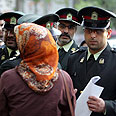 Arresting men and women in Iran Photo: EPA