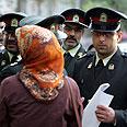 Arresting men and women in Iran Photo: EPA