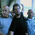 Leftist arrested at airport Photo: Yaron Brener
