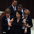 Knesset Member Hanin Zoabi being removed from Knesset Photo: Ohad Zwigenberg
