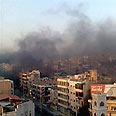 Smoke billows above Hama after regime's shelling Photo: Reuters
