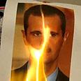 Assad photo set on fire Photo: MCT