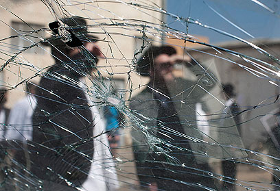 Shattered glass at morning prayer (Photo: EPA)