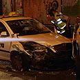 Stolen taxi cab at scene of attack Photo: Motti Kimchi