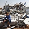Destruction in Migron Photo: AFP