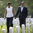Obama and wife Michelle in Virginia military cemetery Photo: AFP