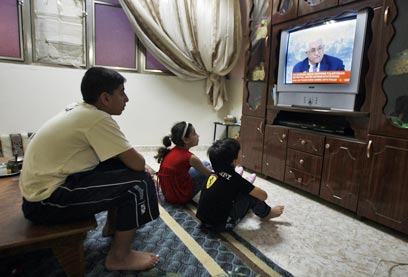 Watching historic speech (Photo: AFP)