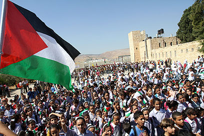 Palestinians take to the streets (Photo: EPA)