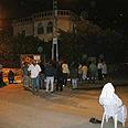 Locals gathered at scene Photo: Ismail al-Hayeb