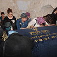 Women praying at gravesite Photo: Meir Brachia, courtesy of Shomron Regional Council
