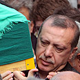 Erdogan carries mother's casket Photo: Reuters