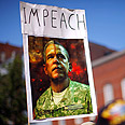 Sign urges to impeach Obama and Bush Photo: Reuters