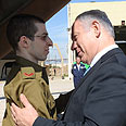 Netanyahu with Shalit on Tuesday Photo:GPO