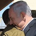 Netanyahu embraces Shalit Photo: GPO