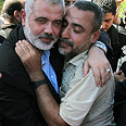 Haniyeh and a freed prisoner Photo: EPA