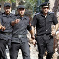 Egyptian officers near Taba Photo: Reuters