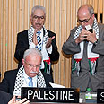 Palestinian delegation after UNESCO vote Photo: EPA