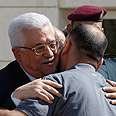 Abbas welcoming home released prisoner Photo: Reuters