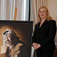 Suha Arafat with portrait of late husband Photo: AFP
