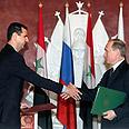 Russian PM Putin with Syria's Assad Photo: EPA