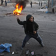 Riots in Shufat Photo: AFP