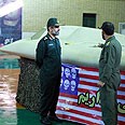 Iranian officials display intact drone Photo: Reuters