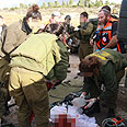 Army attends to Tamimi after injury Photo: Ohad Amiton, Tazpit News Agency