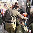 Soldiers treat wounded Palestinian Photo: Ehud Amiton, Tatzpit