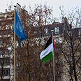 Palestinian flag next to UN flag Photo: Reuters
