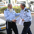Chief military rabbi (R) arrives at conference Photo: Yaron Brener
